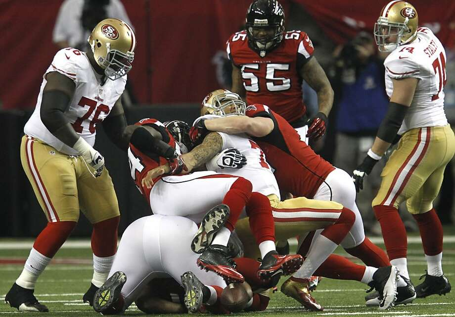 Quarterback Colin Kaepernick (7) is sacked during the fist half of the San Francisco 49ers game against the Atlanta Falcons in the NFC Championship game at the Georgia Dome in Atlanta, GA., on Sunday January 20, 2013. Photo: Brant Ward, The Chronicle