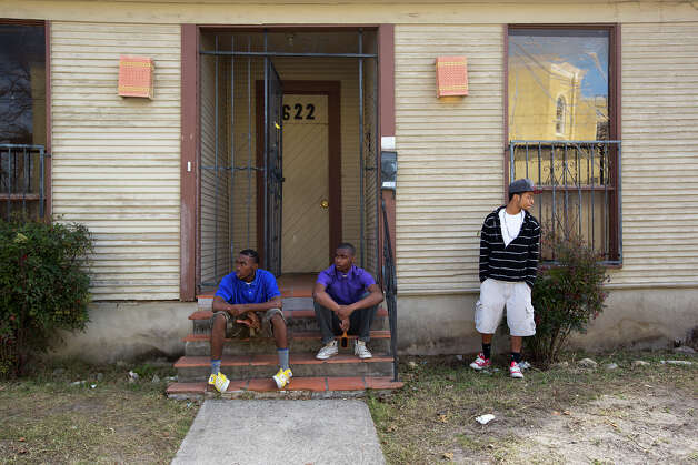 Gregg Randolph, 16, left, Elijah Anthony, 16, center, and L'Chaune Johnson, 18, wait outside before a meeting before the chaperones and students leave for Washington, D.C. at 622 S. Hackberry on Saturday, Jan. 19, 2013. A group of East Side students is being taken to the inauguration ceremonies in Washington, D.C. Photo: Michael Miller, For The Express-News / San Antonio Express-News