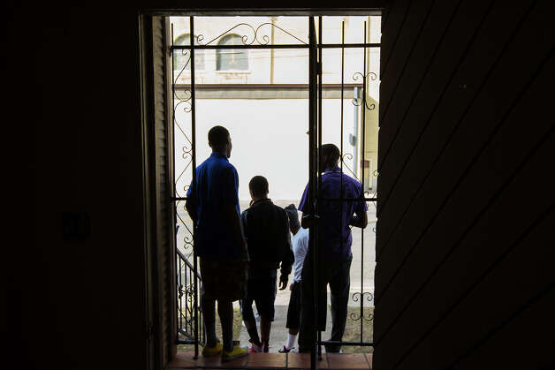 Gregg Randolph, 16, left, Omari Matthews, 13, center, and Elijah Anthony, 16, wait outside before a meeting before the chaperones and students leave for Washington, D.C. at 622 S. Hackberry on Saturday, Jan. 19, 2013. A group of East Side students are being taken to the inauguration ceremonies in Washington, D.C. Photo: Michael Miller, For The Express-News / San Antonio Express-News