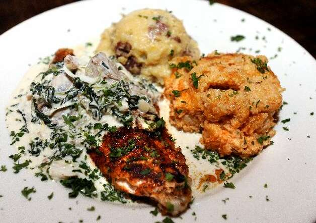 The Blue Point Catfish - a blackened catfish topped with lump crab meat, two blue point oysters, spinach, in a buerre blanc sauce. Randy Edwards/cat5