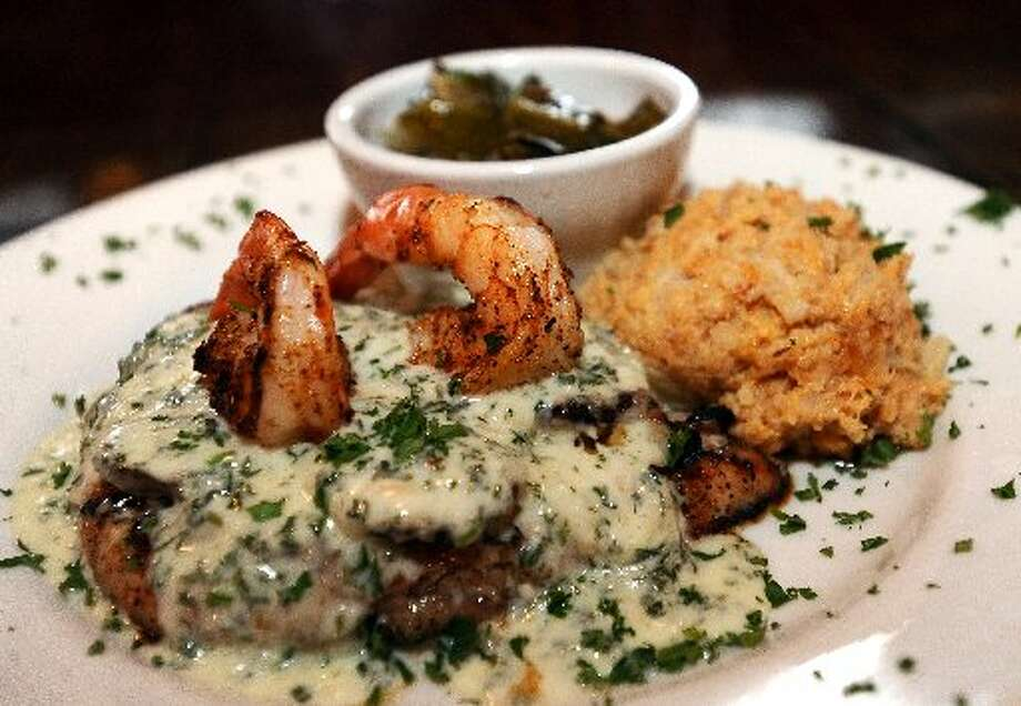 The Tuesday Special at Thibideaux's New Orleans Kitchen - Mushrooom Chicken and Shrimp Parmesan is a blackened chicken that is char-broiled and finished off in the oven and topped with a parmesan buerre blanc sauce and 2 jumbo blackened shrimp. Randy Edwards/cat5