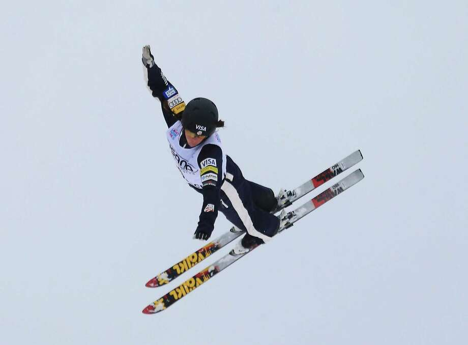 LAKE PLACID, NY - JANUARY 19: Emily Cook #4 of the USA jumps in the qualification round of the USANA Freestyle World Cup aerial competition at the Lake Placid Olympic Jumping Complex on January 19, 2013 in Lake Placid, New York. Photo: Bruce Bennett, Getty Images / 2013 Getty Images