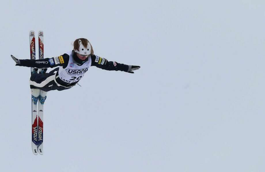LAKE PLACID, NY - JANUARY 19: Madison Olsen #20 of the USA jumps in the qualification round of the USANA Freestyle World Cup aerial competition at the Lake Placid Olympic Jumping Complex on January 19, 2013 in Lake Placid, New York. Photo: Bruce Bennett, Getty Images / 2013 Getty Images