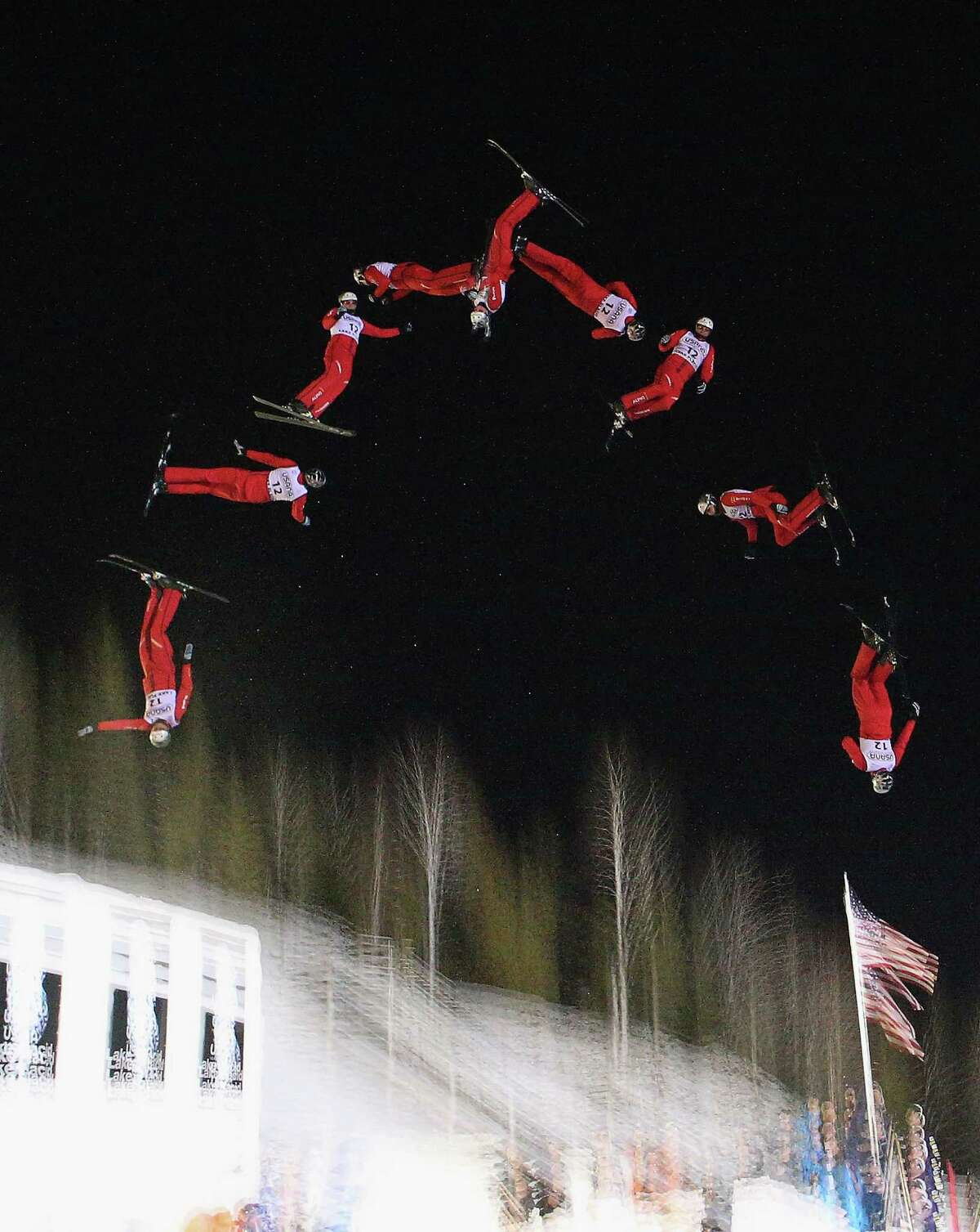 LAKE PLACID, NY - JANUARY 19: (EDITORS NOTE: Multiple exposures were combined in camera to produce this image.) Thomas Lambert #12 of Switzerland jumps in the qualification round of the USANA Freestyle World Cup aerial competition at the Lake Placid Olympic Jumping Complex on January 19, 2013 in Lake Placid, New York.