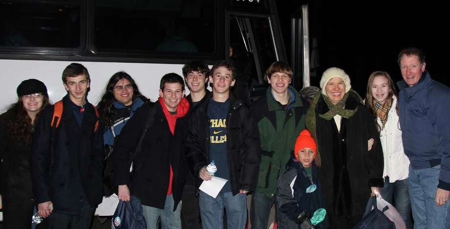 Members of Staples High School's Young Democrats Club prepare to board a bus early Monday, accompanied by Board of Education member Mark Mathias, far right, and his family, to head to Barack Obama's presidential inauguration in Washington, D.C., later in the day.   WESTPORT NEWS, CT 1/21/13 Photo: Contributed Photo / Westport News contributed