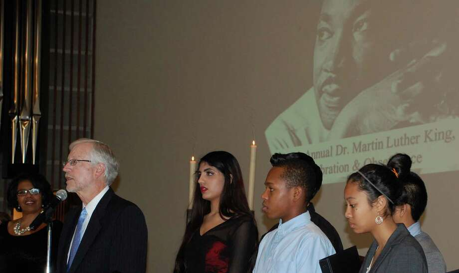 Rev. Edward Horne, left, welcomes people to the United Methodist Church on Sunday afternoon for a service paying tribute to Dr. Martin Luther King Jr. and his legacy.  WESTPORT NEWS, CT 1/20/13 Photo: Jarret Liotta / Westport News contributed