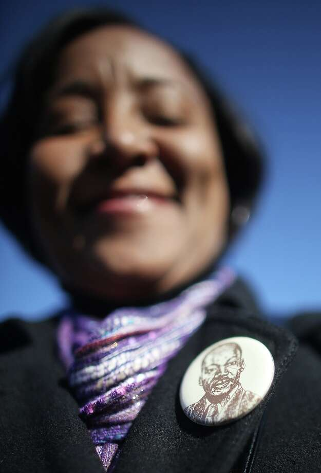 Obama supporter Beverly Rideaux wears a Dr. Martin Luther King Jr. button during preparations for U.S. President Barack Obama's second inauguration on January 20, 2013 in Washington, DC. The U.S. capital is preparing for the second inauguration of U.S. President Barack Obama, which will take place on January 21. Photo: Mario Tama, Getty Images / 2013 Getty Images