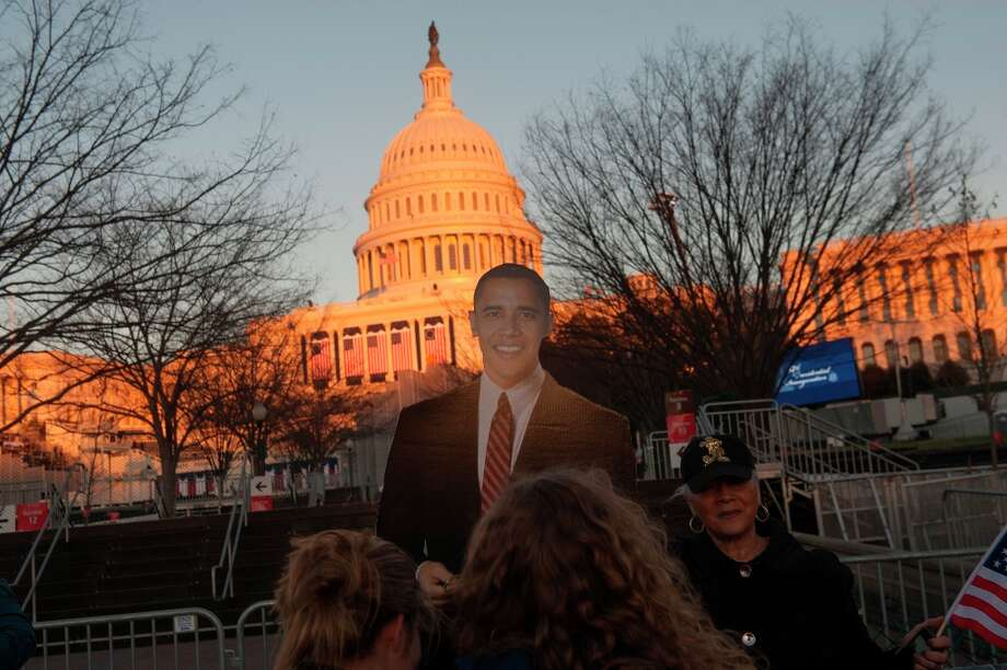 A cardboard cutout of U.S. President Barack Obama is displayed in front of the Capitol building ahead of the presidential inauguration in Washington, D.C., U.S., on Sunday, Jan. 20, 2013. As he enters his second term Obama has shed the aura of a hopeful consensus builder determined to break partisan gridlock and adopted a more confrontational stance with Republicans. Photo: Daniel Acker, Bloomberg / © 2013 Bloomberg Finance LP