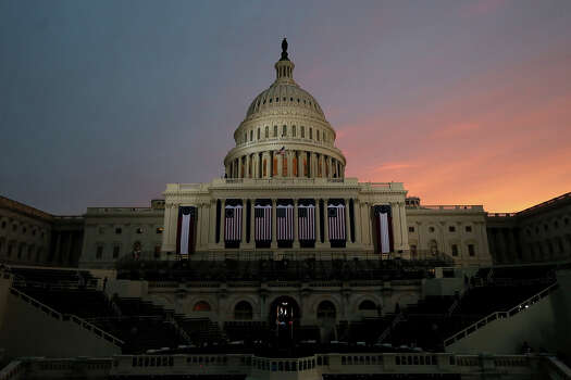 WASHINGTON, DC - JANUARY 21:  The sun rises before the presidential inauguration on the West Front of the U.S. Capitol January 21, 2013 in Washington, DC.  Barack Obama was re-elected for a second term as President of the United States. Photo: Justin Sullivan, Getty Images / 2013 Getty Images