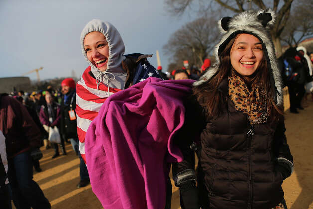 WASHINGTON, DC - JANUARY 21: Susannah Ward (L) and Daniela Zara and others gather near the U.S. Capitol building on the National Mall for the Inauguration ceremony on January 21, 2013 in Washington, DC.  U.S. President Barack Obama will be ceremonially sworn in for his second term today. Photo: Joe Raedle, Getty Images / 2013 Getty Images