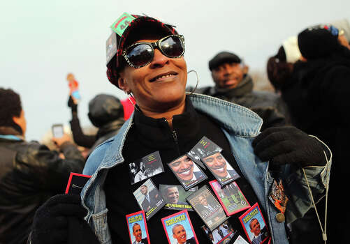 WASHINGTON, DC - JANUARY 21: Lisa Hogue wears pins as she and others gather near the U.S. Capitol building on the National Mall for the Inauguration ceremony on January 21, 2013 in Washington, DC.  U.S. President Barack Obama will be ceremonially sworn in for his second term today. Photo: Joe Raedle, Getty Images / 2013 Getty Images