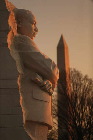 WASHINGTON, DC - JANUARY 21:  The Martin Luther King Jr. Memorial stands at sunrise in front of the Washington Monument before the Inauguration ceremony on January 21, 2013 in Washington, DC. U.S. President Barack Obama, will be ceremonially sworn in for his second term today which coincides the Martin Luther King Day Jr. day, a federal holiday. Photo: Mario Tama, Getty Images / 2013 Getty Images