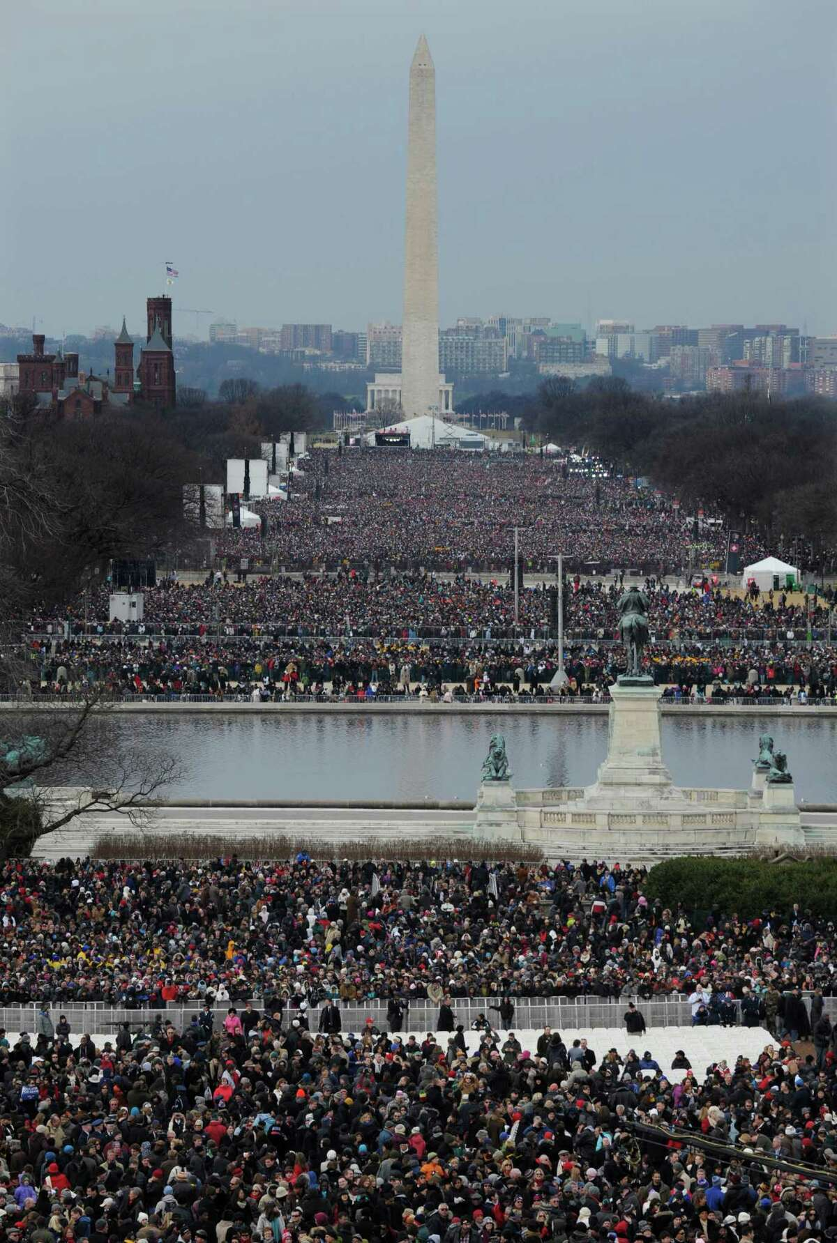 Crowds congregate in The National Mall for the ceremonial swearing-in for President Barack Obama at the U.S. Capitol during the 57th Presidential Inauguration in Washington, Monday, Jan. 21, 2013.