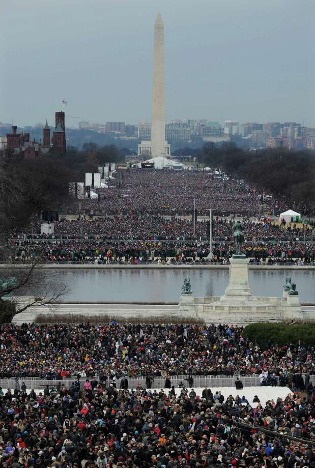 Crowds congregate in The National Mall for the ceremonial swearing-in for President Barack Obama at the U.S. Capitol during the 57th Presidential Inauguration in Washington, Monday, Jan. 21, 2013. Photo: Susan Walsh