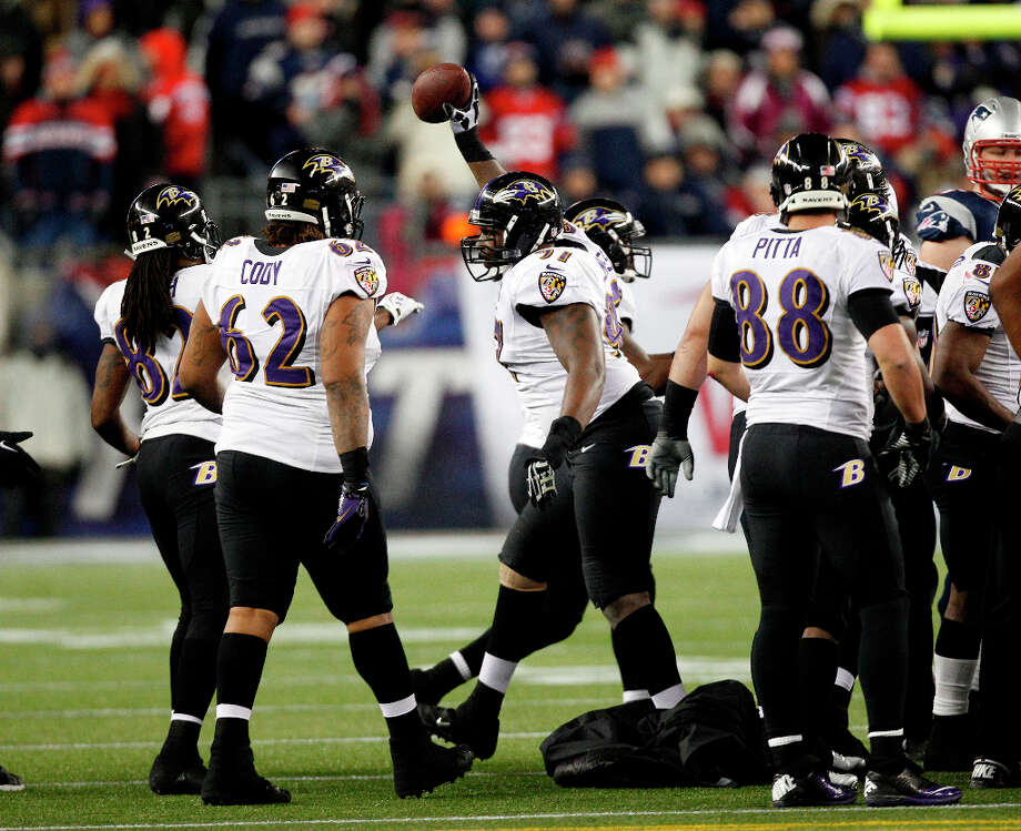 Ravens defensive end Arthur Jones, center, celebrates his fumble recovery against the Patriots. Photo: Stephan Savoia, Associated Press / AP