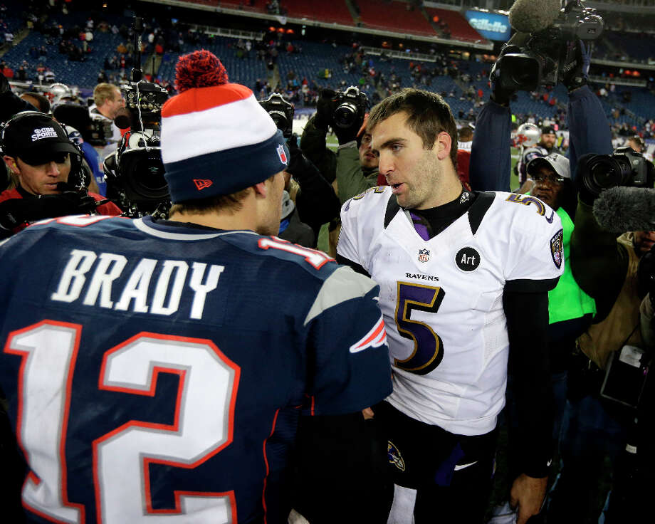 Patriots quarterback Tom Brady (12) meets with Ravens quarterback Joe Flacco (5) after the AFC Championship game. Photo: Steven Senne, Associated Press / AP