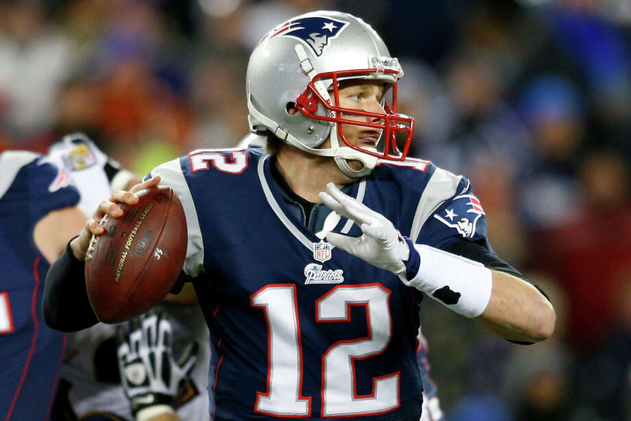 Tom Brady drops back to pass against the Ravens. Photo: Jim Rogash, Getty Images / 2013 Getty Images