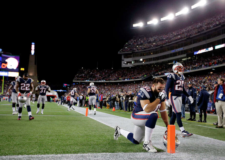 Rob Ninkovich (50) kneels in the endzone before the AFC Championship game. Photo: Matt Slocum, Associated Press / AP