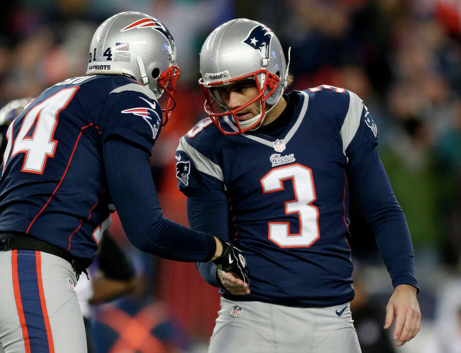 Patriots kicker Stephen Gostkowski (3) is congratulated by punter Zoltan Mesko (14) after kicking a 32- yard field goal. Photo: Steven Senne, Associated Press / AP