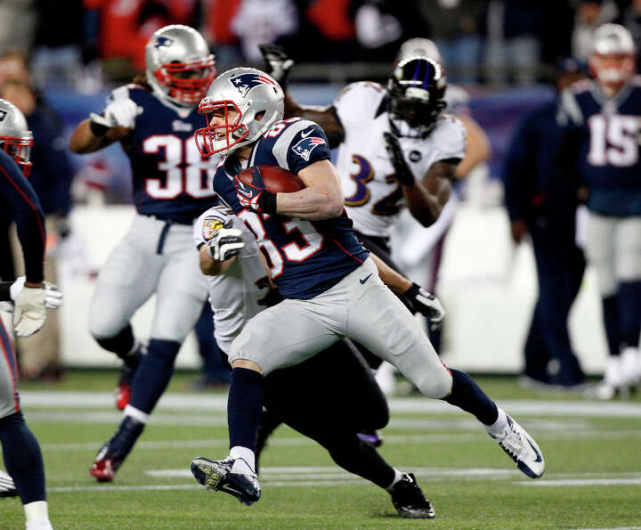 Patriots wide receiver Wes Welker (83) returns a punt against the Ravens.