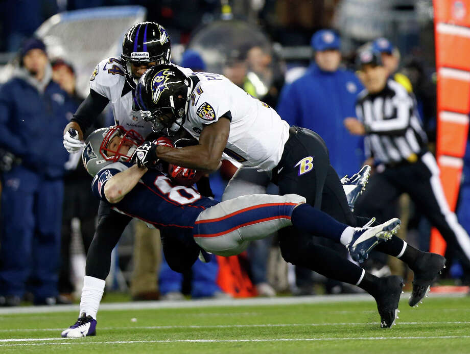 Wes Welker #83 of the Patriots catches a pass over Bernard Pollard #31 and Corey Graham #24 of the Ravens. Photo: Jared Wickerham, Getty Images / 2013 Getty Images