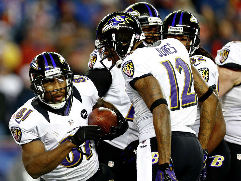 Anquan Boldin #81 of the Ravens celebrates with teammate Jacoby Jones #12 after scoring a touchdown.
