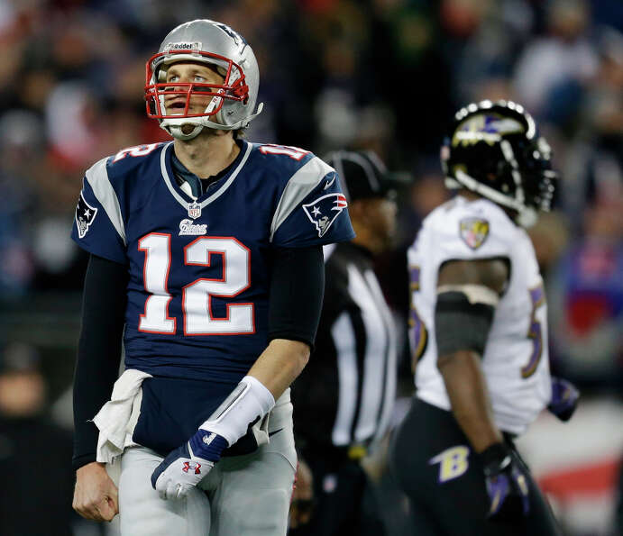 Patriots quarterback Tom Brady looks up at the scoreboard.