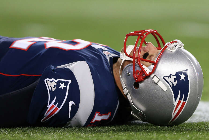 Tom Brady #12 of the Patriots lays on the ground.
