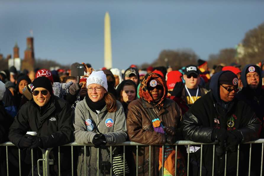 People gather near the U.S. Capitol building on the National Mall for the Inauguration ceremony on J
