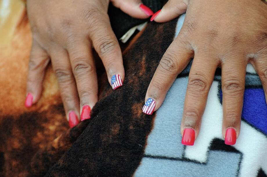 Carol Bishop, of Charlotte, North Carolina, displays her patriotic manicure for the inauguration of U.S. President Barack Obama in Washington, D.C., Monday, January 21, 2013. Photo: AndrÈ Chung, McClatchy-Tribune News Service / MCT