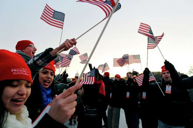 Spectators wave American flags on the National Mall in Washington, Monday, Jan. 21, 2013, before the start of President Barack Obama's ceremonial swearing-in ceremony during the 57th Presidential Inauguration. Photo: Jose Luis Magana, Associated Press / FR159526 AP