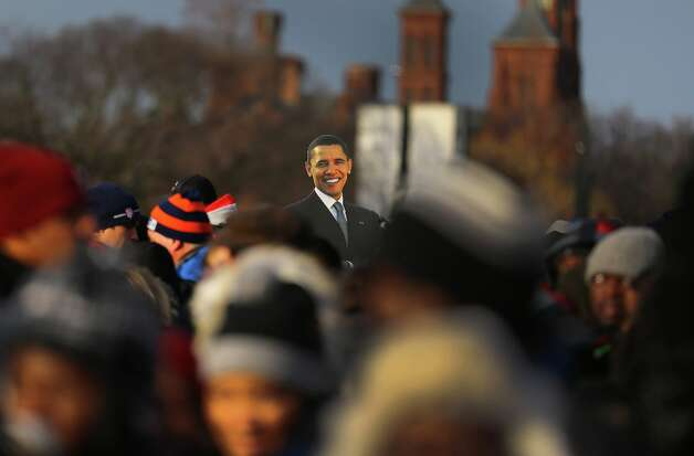 A cut-out of President Barack Obama is seen in the crowd as people gather near the U.S. Capitol building on the National Mall for the Inauguration ceremony on January 21, 2013 in Washington, DC.  U.S. President Barack Obama will be ceremonially sworn in for his second term today. Photo: Joe Raedle, Getty Images / 2013 Getty Images