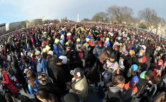 People attend the 57th Presidential Inauguration on January 21, 2013. US President Barack Obama will be sworn in for a second term.   AFP PHOTO/MLADEN ANTONOVMLADEN ANTONOV/AFP/Getty Images Photo: MLADEN ANTONOV, AFP/Getty Images / AFP
