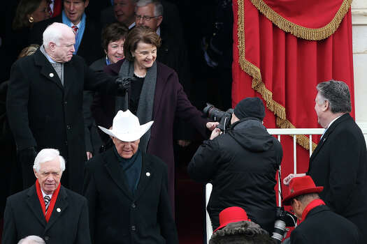 WASHINGTON, DC - JANUARY 21:  U.S. Sen John McCain (R-AZ) (L) and U.S. Sen. Dianne Feinstein (D-CA) gesture to U.S. Rep. Peter King (R) during the presidential inauguration on the West Front of the U.S. Capitol January 21, 2013 in Washington, DC.   Barack Obama was re-elected for a second term as President of the United States. Photo: Justin Sullivan, Getty Images / 2013 Getty Images