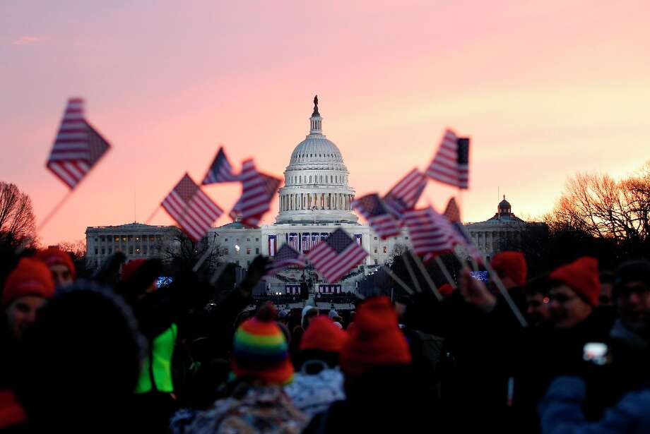 President Barack Obama supporters wave American flags on the National Mall in Washington, Monday, Jan. 21,  2013, prior to the start of President Barack Obama's ceremonial swearing-in ceremony during the 57th Presidential Inauguration. Photo: Jose Luis Magana, Associated Press / FR159526 AP