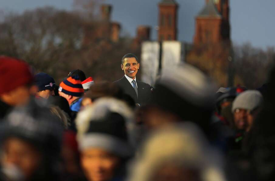 A cut-out of President Barack Obama is seen in the crowd as people gather near the U.S. Capitol buil