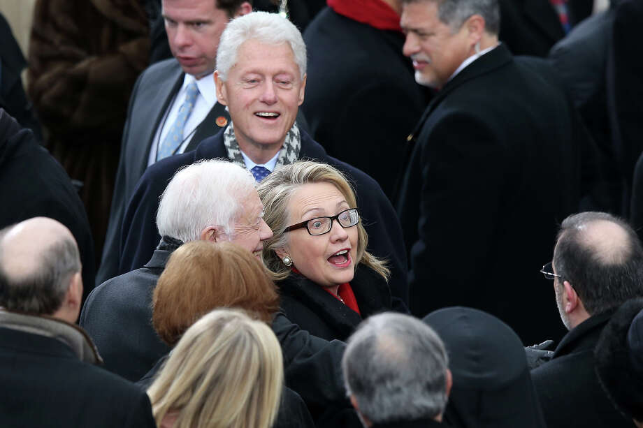 WASHINGTON, DC - JANUARY 21:  U.S. Secretary of State Hillary Clinton (C), former U.S. President Bill Clinton and former U.S. President Jimmy Carter arrive during the presidential inauguration on the West Front of the U.S. Capitol January 21, 2013 in Washington, DC.   Barack Obama was re-elected for a second term as President of the United States. Photo: Mark Wilson, Getty Images / 2013 Getty Images