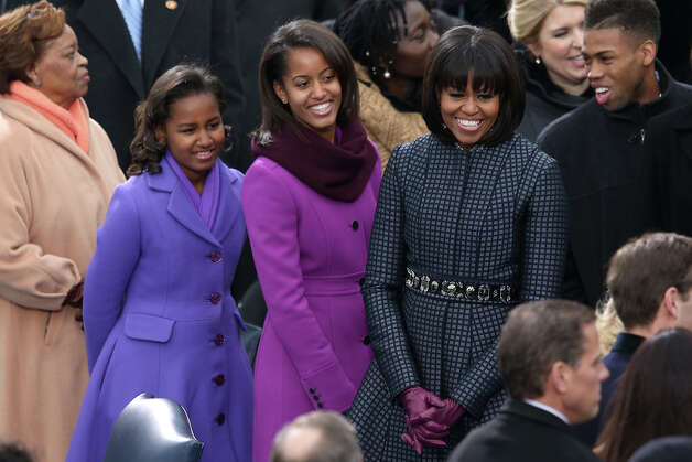 WASHINGTON, DC - JANUARY 21:  First lady Michelle Obama and daughters, Sasha Obama and Malia Obama arrive during the presidential inauguration on the West Front of the U.S. Capitol January 21, 2013 in Washington, DC.   Barack Obama was re-elected for a second term as President of the United States. Photo: Mark Wilson, Getty Images / 2013 Getty Images