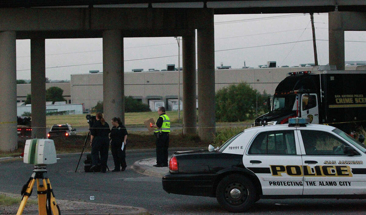 San Antonio police investigate Thursday July 11, 2013 under Interstate highway 35 near the AT&T Parkway exit where the body of a man was found in a turnaround lane. Police say the man had been shot and there was a trail of blood on the southbound feeder road. The incident is still being investigated.