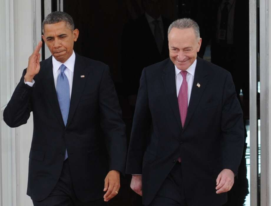 US President Barack Obama and US Democratic Senator from New York Chuck Schumer, the chairman of the Joint Congressional Committee on Inaugural Ceremonies, leave the White House on January 21, 2013 for the US Capitol in Washington, DC, for the ceremonial swearing in of the president and vice president to a second term in office. Photo: ROD LAMKEY JR., AFP/Getty Images / AFP