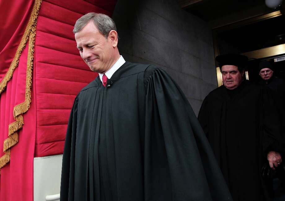 Supreme Court Chief Justice John Roberts arrives during the presidential inauguration on the West Front of the US Capitol January 21, 2013 in Washington, DC.   Barack Obama was re-elected for a second term as President of the United States. Photo: WIN MCNAMEE, AFP/Getty Images / 2013 Getty Images