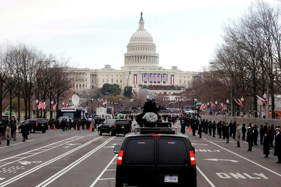 President Barack Obama and first lady Michelle Obama ride up Pennsylvania Avenue in the presidential motorcade towards the U.S. Capitol in Washington, Monday, Jan. 21, 2013, ahead of his ceremonial swearing in during the 57th Presidential Inauguration. Photo: Charles Dharapak, Associated Press / AP