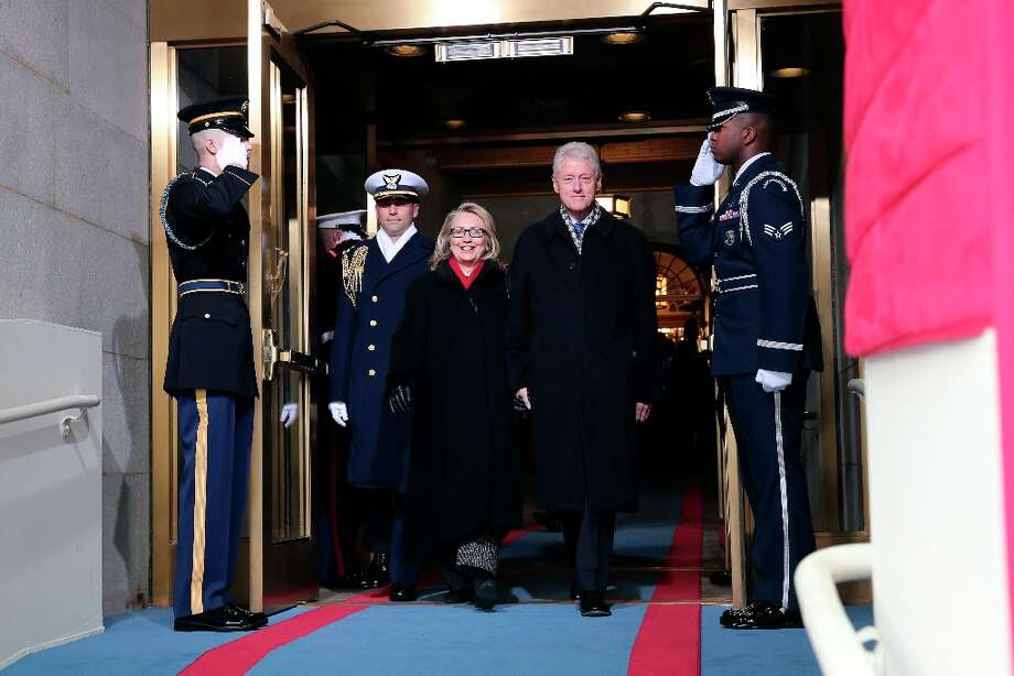 Secretary of State Hillary Rodham Clinton and former President Bill Clinton arrive on the West Front of the Capitol in Washington, Monday, Jan. 21, 2013, for the Presidential Barack Obama's ceremonial swearing-in ceremony during the 57th Presidential Inauguration. Photo: Win McNamee, Associated Press / Pool Getty Images North America