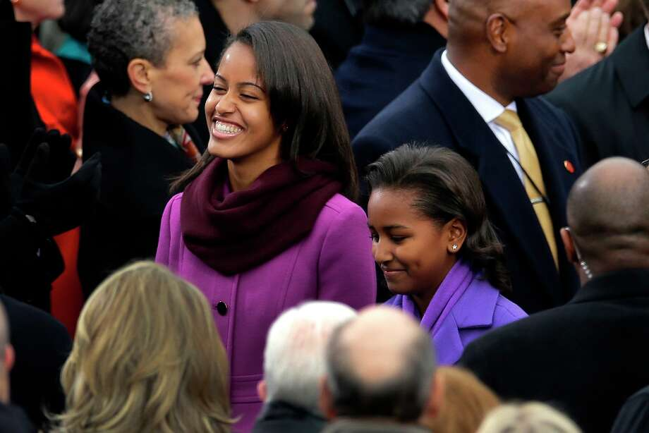 Malia Obama and Sasha Obama arrive at the ceremonial swearing-in for President Barack Obama at the U.S. Capitol during the 57th Presidential Inauguration in Washington, Monday, Jan. 21, 2013. Photo: Carolyn Kaster, Associated Press / AP