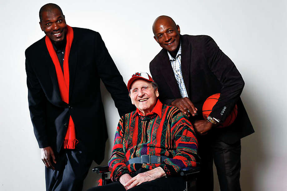 University of Houston Men's Basketball Coach, Guy Lewis, (center) is photographed with Hakeem Olajuwon (left) and Clyde Drexler at Hofheinz Pavilion, Thursday, Jan. 13, 2011, in Houston. Photo: Michael Paulsen, Houston Chronicle / Houston Chronicle
