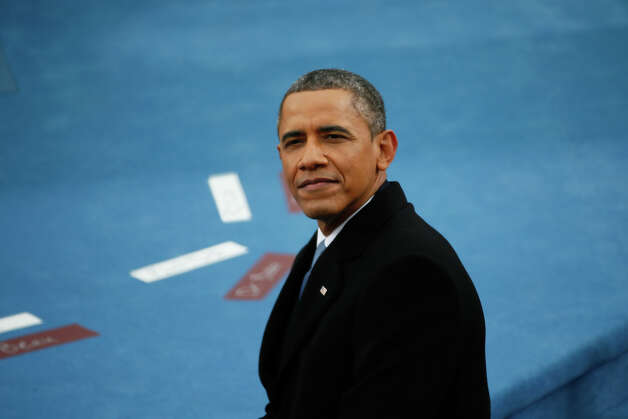 WASHINGTON, DC - JANUARY 21:  U.S. President Barack Obama looks on during the presidential inauguration on the West Front of the U.S. Capitol January 21, 2013 in Washington, DC.   Barack Obama was re-elected for a second term as President of the United States. Photo: Rob Carr, Getty Images / 2013 Getty Images