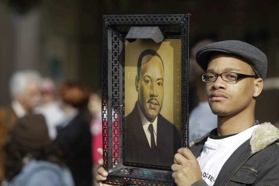 People  participating in the Black Heritage Society MLK Parade Monday, Jan. 21, 2013 in Houston. Photo: .
