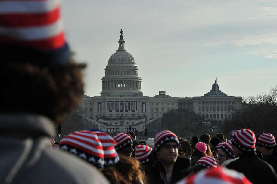 People attend the 57th Presidential Inauguration on January 21, 2013. US President Barack Obama was officially sworn in for a second term on January 20, 2013. Photo: MLADEN ANTONOV, AFP/Getty Images / AFP