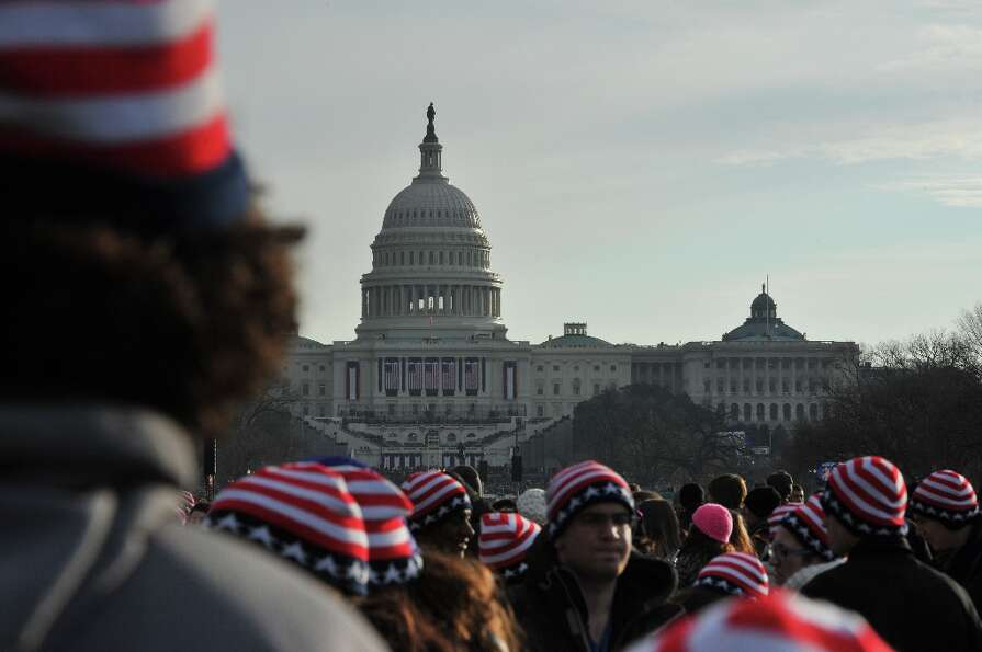 People attend the 57th Presidential Inauguration on January 21, 2013. US President Barack Obama was