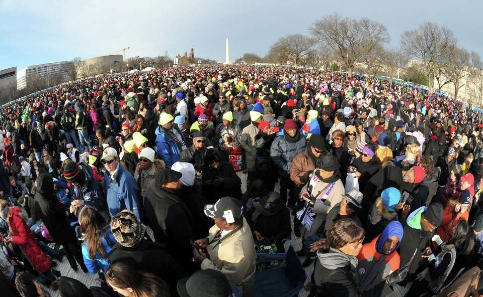 People attend the 57th Presidential Inauguration on January 21, 2013. US President Barack Obama will